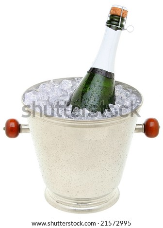 Champagne bottle in an ice bucket - stock photo