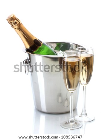 Champagne bottle in bucket with ice and glasses of champagne, isolated on white - stock photo