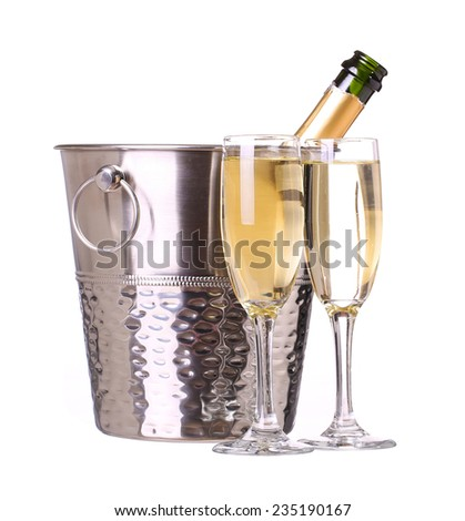 Champagne bottle in bucket with ice and glasses of champagne, isolated on white background - stock photo