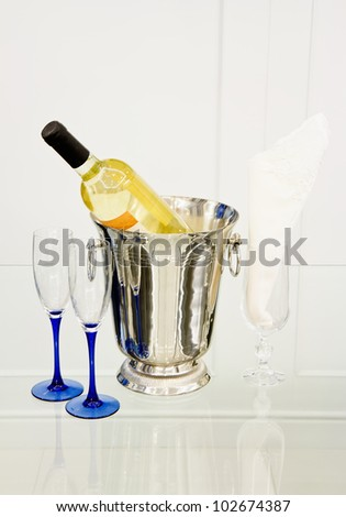 Champagne bottle in cooler - stock photo