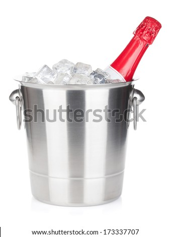 Champagne bottle in ice bucket. Isolated on white background - stock photo