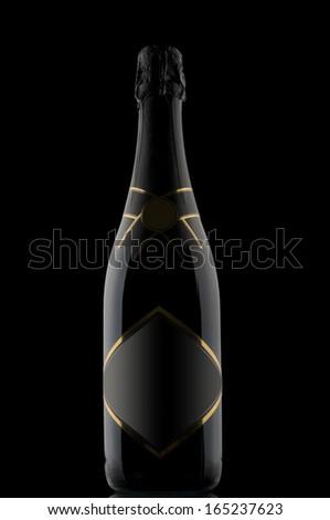 Champagne bottle on black backdrop - stock photo