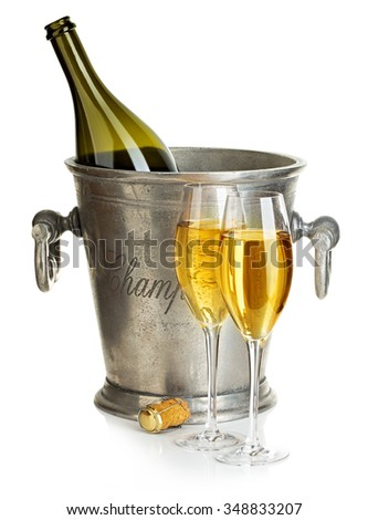 Champagne bottle with bucket ice and glasses of champagne, isolated on white. Festive still life. - stock photo