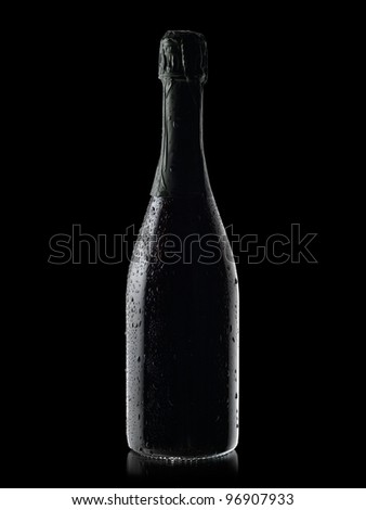 Champagne bottle with drops - stock photo