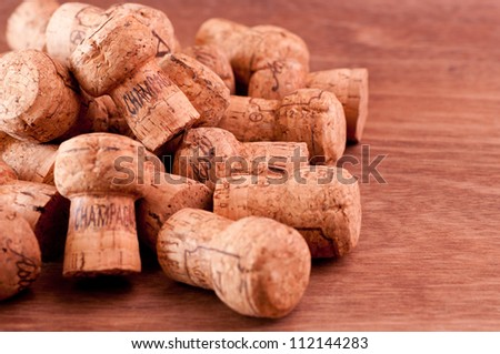 Champagne  corks close up on a wooden table - stock photo