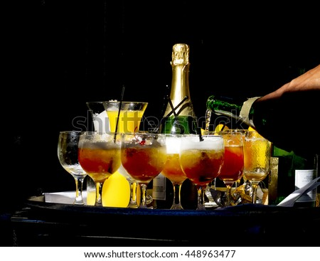 Champagne drinks being prepared at restaurant. - stock photo