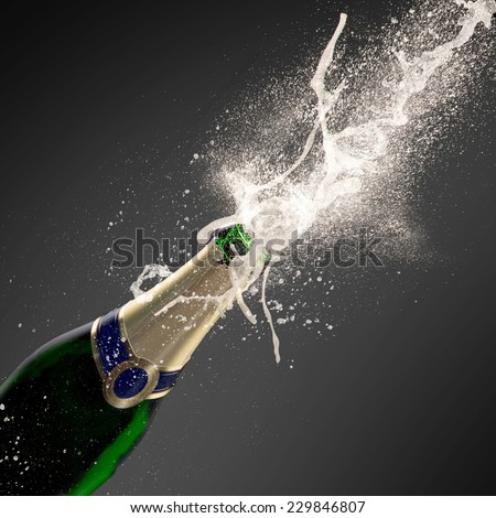Champagne explosion on black background, celebration theme. - stock photo