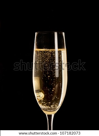 Champagne flute isolated on black - stock photo