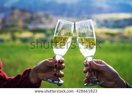 Champagne flute raised after hot air balloon - stock photo