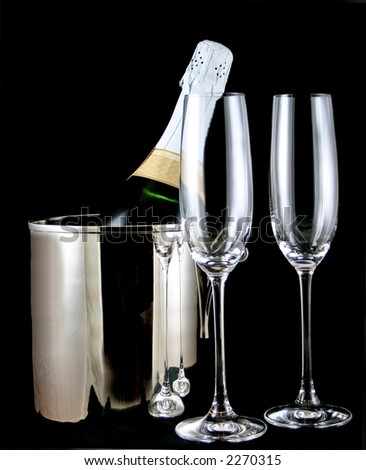 Champagne, Flutes, and Ice Bucket Against Black - stock photo