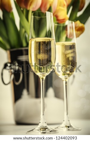 champagne flutes and tulips - stock photo
