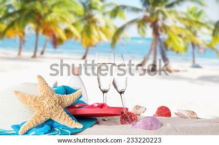 Champagne flutes on sunny beach, celebration theme. - stock photo