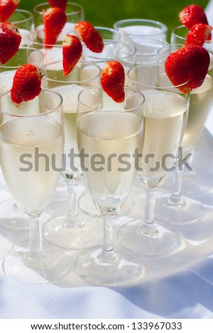 Champagne flutes with strawberries - stock photo