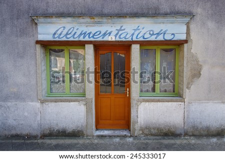 CHAMPAGNE, FRANCE - SEPTEMBER 24: Traditional alimentation local shop in north-west side of France, on streets of Champagne town. Photo taken on September 24, 2011 in Champagne  - stock photo