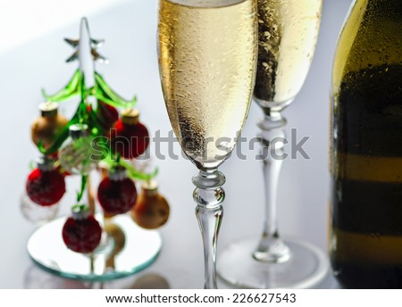 Champagne glasses and Christmas tree - stock photo