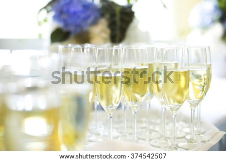Champagne glasses being served at a party  - stock photo
