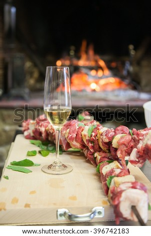 Champagne glasses in beautiful kitchen with fireplace - stock photo
