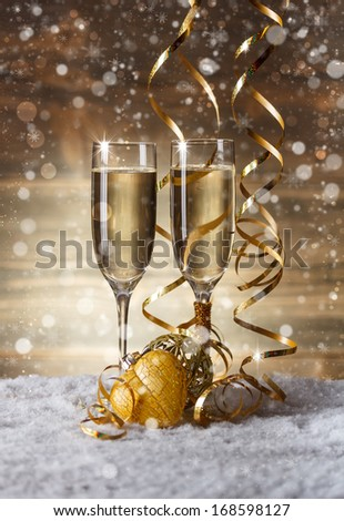 Champagne glasses in Christmas setting - stock photo