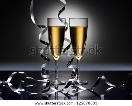 Champagne glasses in New Years party look - stock photo