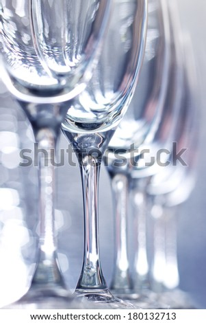 Champagne Glasses on a light blue background - stock photo