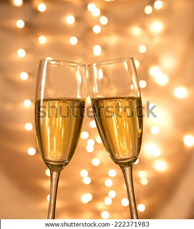 Champagne glasses on light bokeh background - stock photo