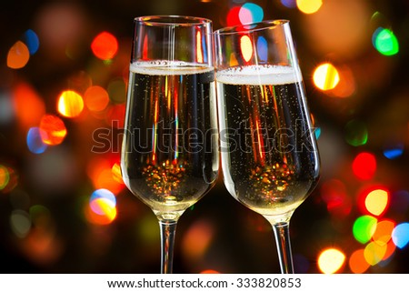 Champagne glasses on the background of Christmas lights - stock photo