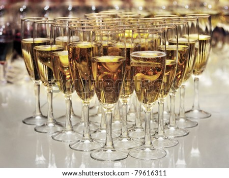 champagne glasses on the table, party 2010 - stock photo