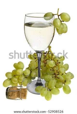 Champagne in a wineglass  and bunch fresh grapes fruits  isolated on a white background - stock photo