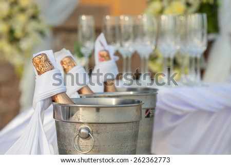 Champagne in ice bucket - stock photo
