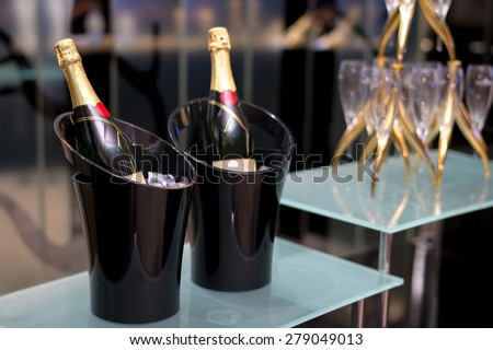 Champagne on champagne bucket over the bar in restaurant - stock photo