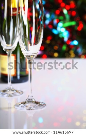 Champagne on Christmas tree background - stock photo