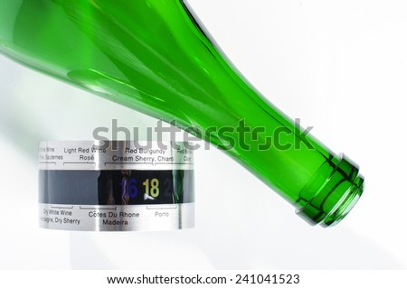 Champagne or sparkling wine bottle and wine thermometer - stock photo