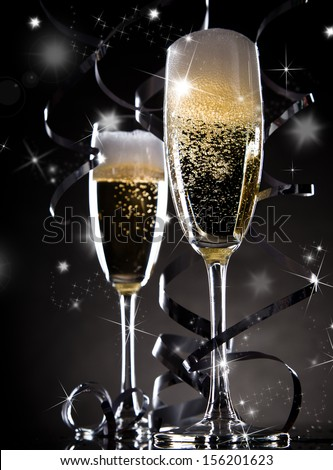 Champagne over black background. Celebration theme. - stock photo