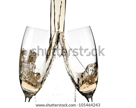 Champagne pouring in two glasses - stock photo