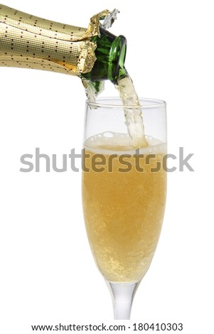 champagne pouring into tall glass on white  - stock photo