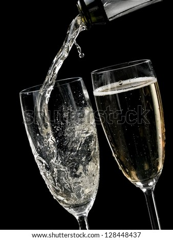 Champagne start to pouring from a bottle - stock photo
