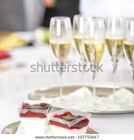 Champagne toast glasses for business meeting conference participants - stock photo