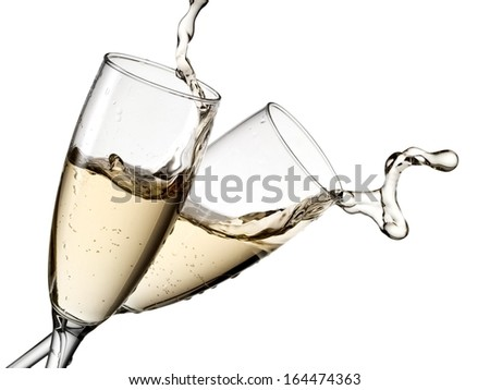Champagne up from two glasses - stock photo