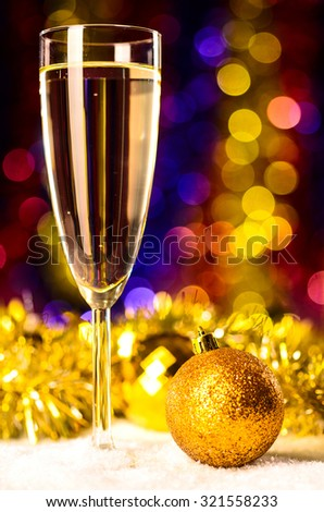 champagne with christmas toys on blurred background - stock photo