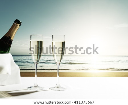 champaign Glasses and sunset on Seychelles beach - stock photo