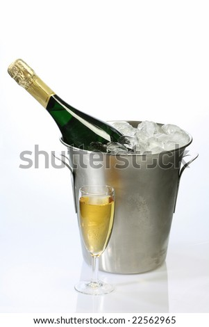 Champaigne bottle in a container with ice on bright background - stock photo