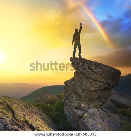 Champion on mountain peak during sunrise. Beautiful summer landscape - stock photo