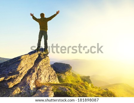 Champion on mountain peak. Sport and active life concept - stock photo
