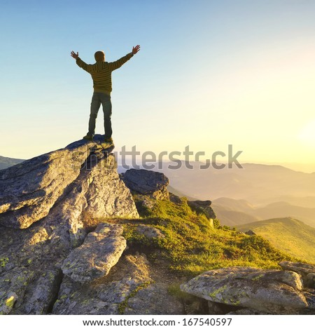 Champion on the mountain top. Sport and active life concept - stock photo