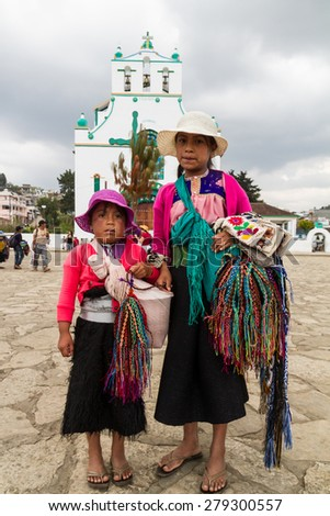 CHAMULA, MEXICO - March 24, 2015: Indian sisters selling bracelets at the church in San Juan Chamula, Mexico - stock photo