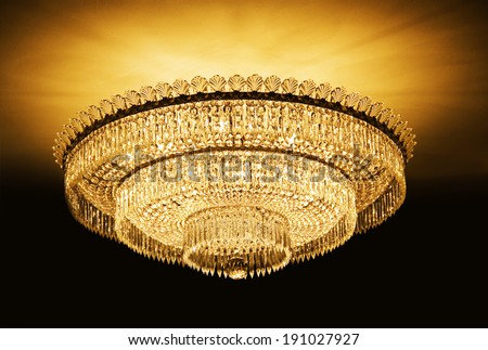 Chandelier hanging under a ceiling in a palace - stock photo