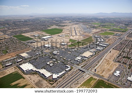 Chandler, Arizona Airport and the Loop 202 freeway with surrounding homes, retail, office and business development - stock photo