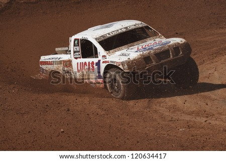 CHANDLER, AZ - MAR 30: Carl Renezeder (1) at speed in Pro 4 Unlimited Lucas Oil Off Road Series racing qualifying on March 30, 2012 at Firebird International Raceway in Chandler, AZ. - stock photo