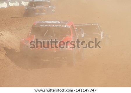 CHANDLER, AZ - OCT 26: Harty Hart (15) at speed in Pro 2 Unlimited Lucas Oil Off Road Series racing qualifying on October 26, 2012 at Firebird International Raceway in Chandler, AZ. - stock photo