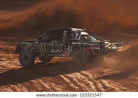 CHANDLER, AZ - OCT 26: RJ Anderson (37) at speed in Pro Lite Unlimited Lucas Oil Off Road Series racing qualifying on October 26, 2012 at Firebird International Raceway in Chandler, AZ. - stock photo